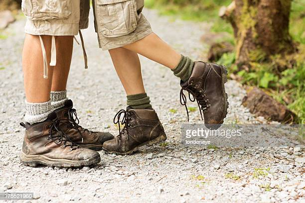 female hiker standing on toe with man - leg kissing stock photos and pictures