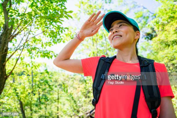 female hiker walking around mountain - 45 49 years stock pictures, royalty-free photos & images