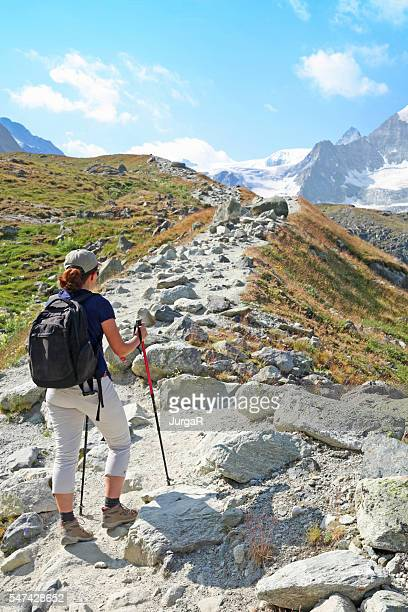 Female Hiker Walking on Mountain Track in the Swiss Alps