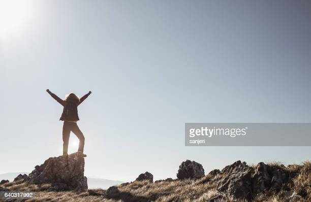 Female Hiker With Raised Arms on Top of The Hill