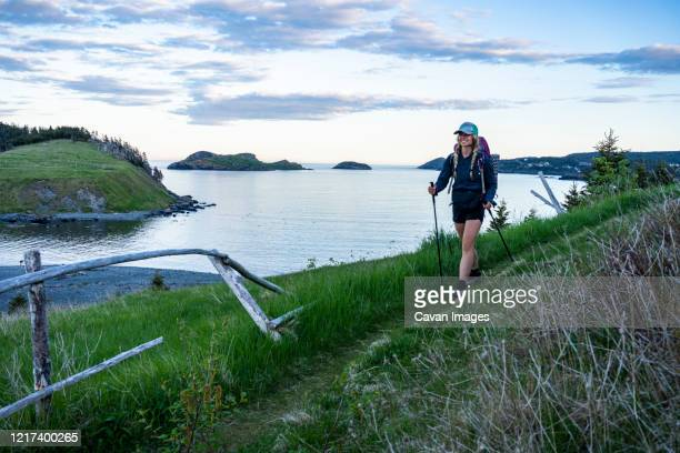 female hiking mickeleens path on east coast trail witless bay - east stock pictures, royalty-free photos & images