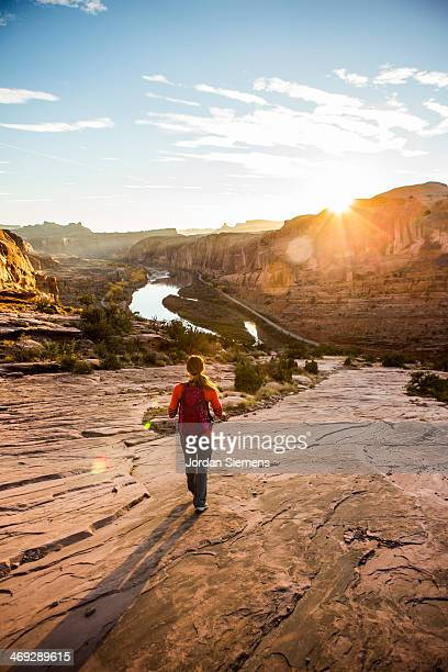 female hiking trail at sunset - moab utah stock pictures, royalty-free photos & images