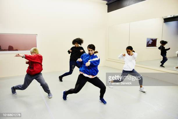 Female hip hop dance group practicing in dance studio
