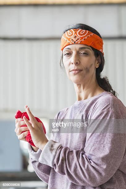 Female, Hispanic blue collar worker