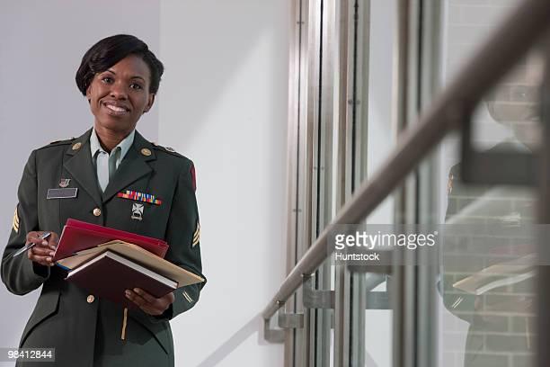 female hispanic nurse in the us army holding diaries - 将校 ストックフォトと画像