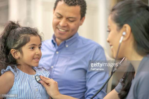 a female hispanic physician - health insurance stock pictures, royalty-free photos & images