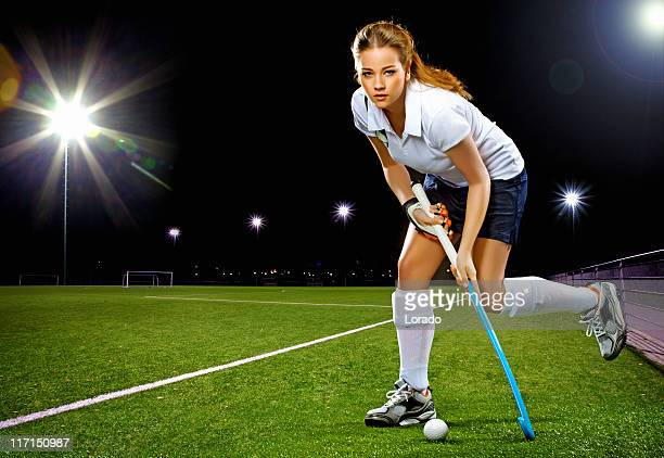 female hockey player running