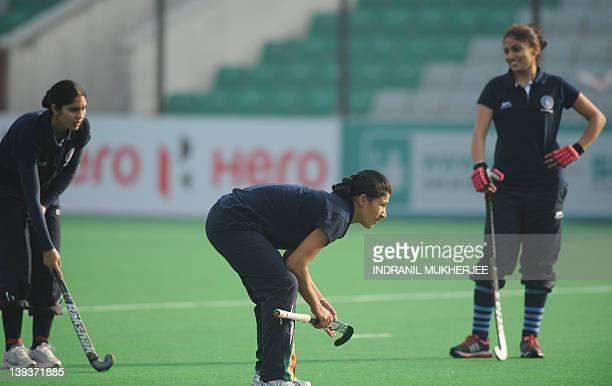 Female hockey players of India Jasjeet Kaur Rani Rampal and Joydeep Kaur take a break while practising a penalty corner at a training session on the...