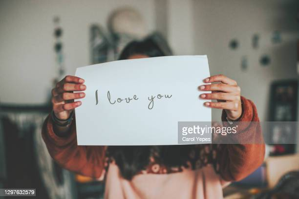 female holding a paper wiht i love you text - i love you stock pictures, royalty-free photos & images