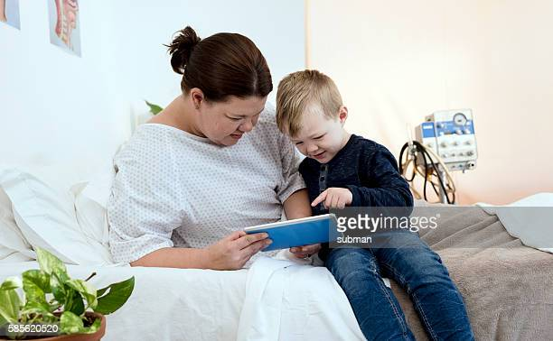 Female Hospital Patient With Her Young Son