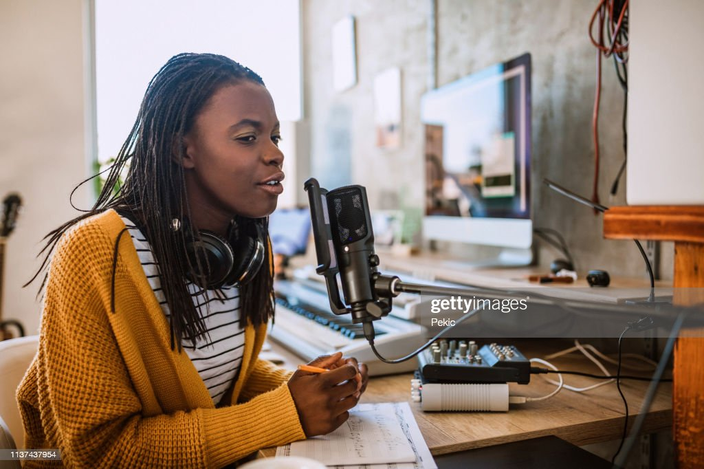 Female host on radio station : Stock Photo