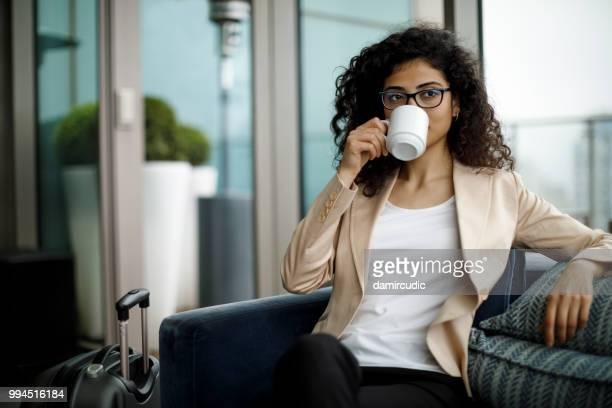 Female hotel guest enjoying coffee at a cafe