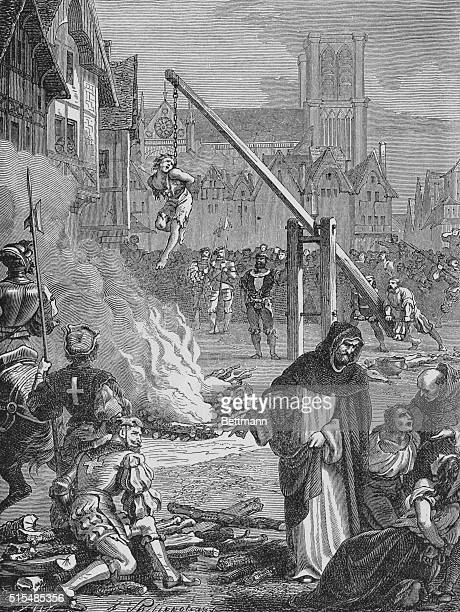 A female Huguenot tethered to a chain hangs in mid air during the religious persecution of French protestants
