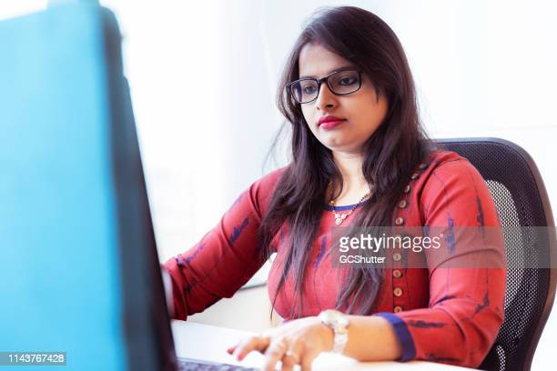 female human resource manger at her office - maharashtra stock pictures, royalty-free photos & images