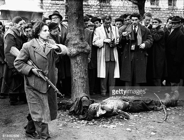 A female Hungarian resistance fighter carries a gun during the Hungarian Revolution of 1956 Photojournalists witness death starvation and desolation...