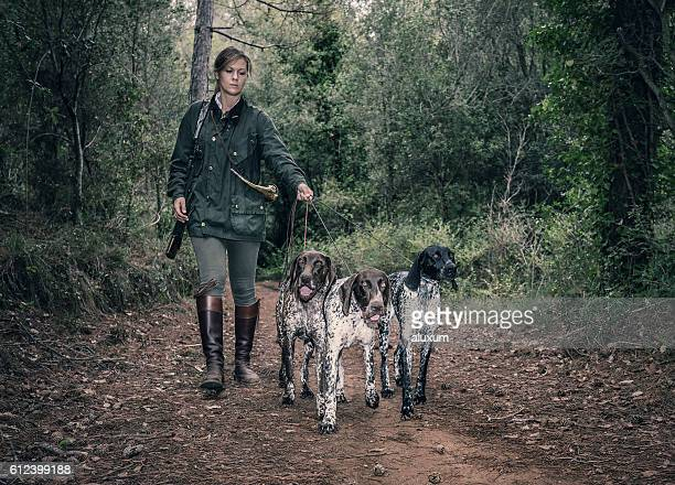 female hunter with german shorthaired pointers - hunting dog stock pictures, royalty-free photos & images