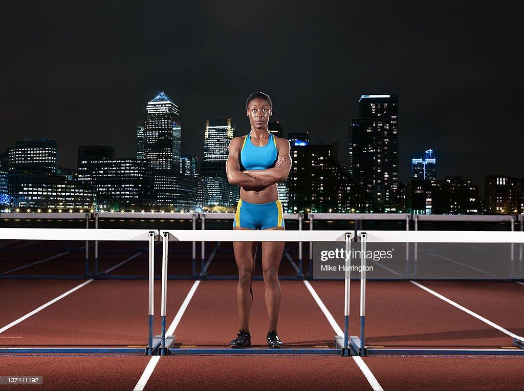 Female Hurdler Standing On Track In London : Stock Photo