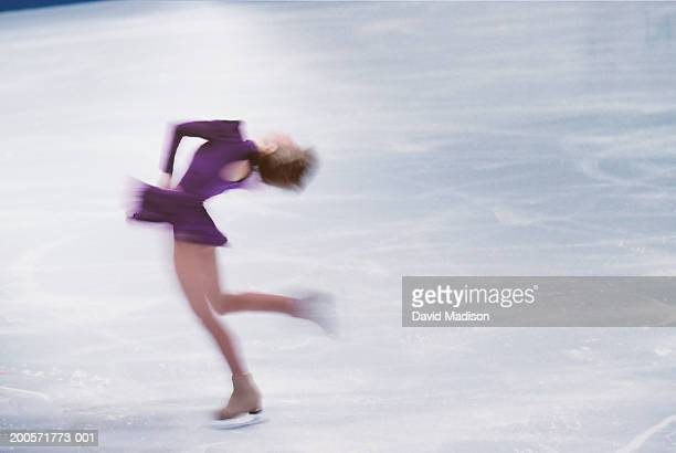 female ice skater spinning on ice - madison grace stock pictures, royalty-free photos & images