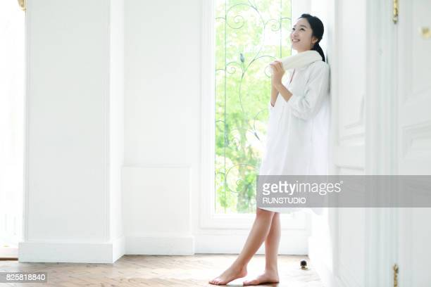 female image laughing at home and resting