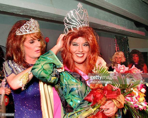 Female impersonator Joel Thomson portraying Desiray adjusts his crown during the beauty queen competition of the Miss Fantasy Fest late 24 October...