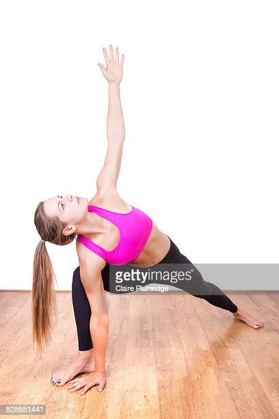 female in a yoga position - claire plumridge stock pictures, royalty-free photos & images