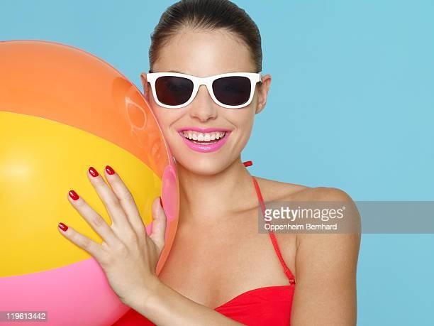 female in bikini holding beach ball - femme maillot de bain photos et images de collection