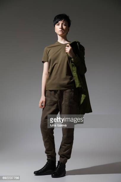 female in military clothing - khaki stock pictures, royalty-free photos & images