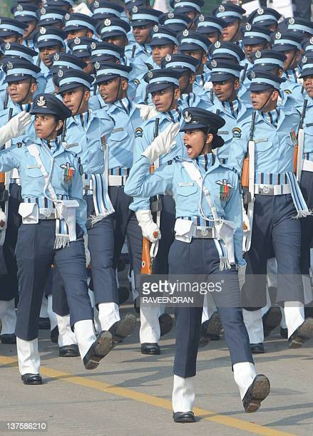 A female Indian Air Force officer salutes as she and her comrades march down Rajpath during the final full dress rehearsal for the Indian Republic...