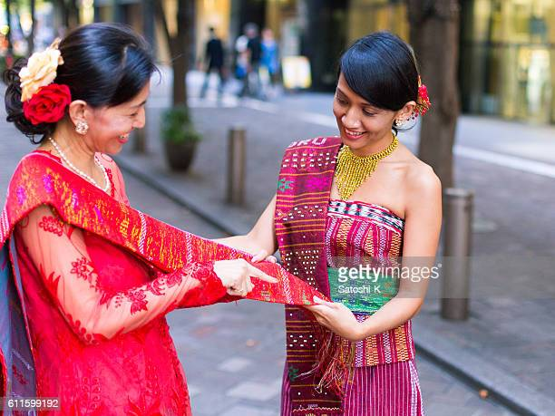 Female Indonesian friends talking about their traditional outfit