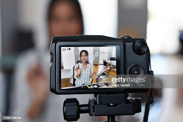 female influencer recording make-up tip videos for her blog - influencer stock pictures, royalty-free photos & images
