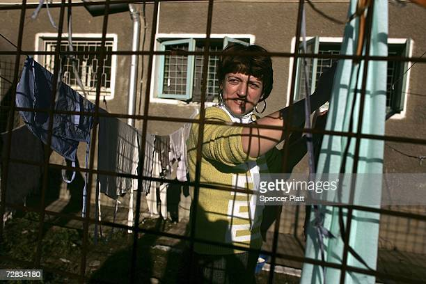 A female inmate folds laundry at the only female prison in Romania December 15 2006 in Targsor Romania The prison with inmates from 17 to the 70...