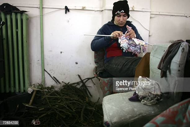 A female inmate knits at the only female prison in Romania December 15 2006 in Targsor Romania The prison with inmates from 17 to the 70 years old...