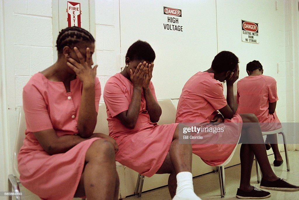 Female Inmates Hiding their Faces : Stock Photo