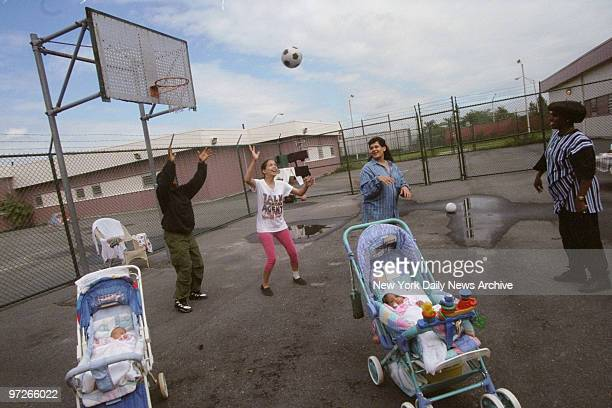 Female inmates in the Rikers Island nursery program play basketball as their babies nap nearby