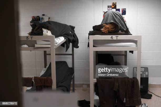 Female inmates lie on bunks in an overcrowded cell the Pueblo County Detention Center on Wednesday December 6 2017 The jail which is currently well...