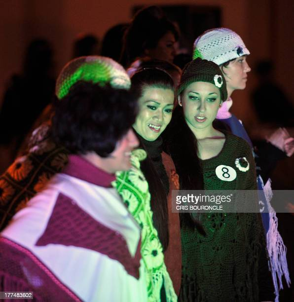 Female inmates participate in a fashion show at the Piedras Gordas Model Penitentiary 11 km north of Lima on August 22 2013 Women most of them...