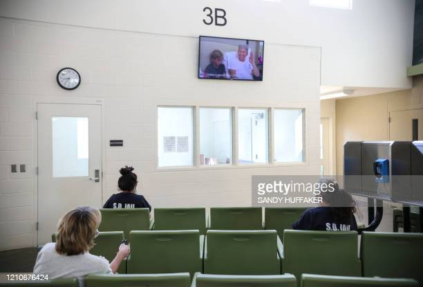 Female inmates sit apart while watching TV at Las Colinas Women's Detention Facility in Santee California on April 22 2020 Inmates and Sheriff's...