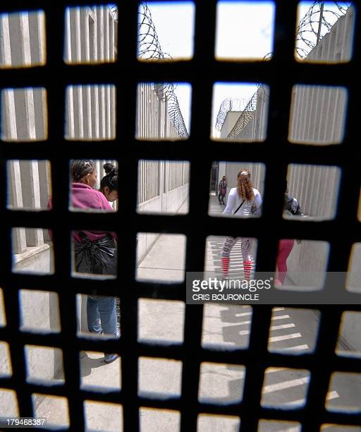 Female inmates wait to be move from one containment area to another at the Ancon 2 prison part of the Piedras Gordas Model Penitentiary complex about...