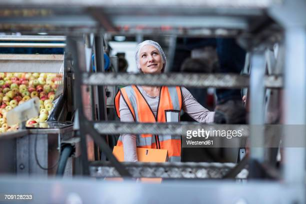 Female inspector in food processing plant