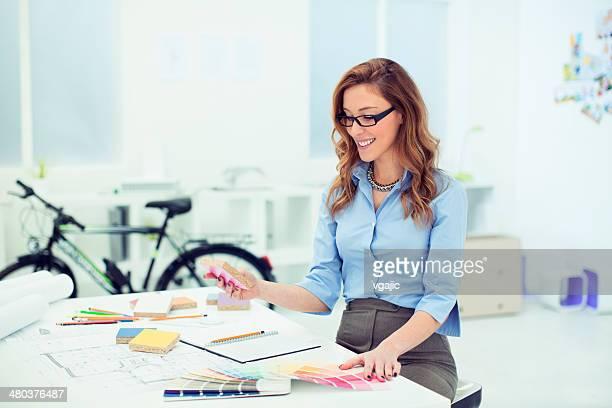 Female Interior Designer At Work.