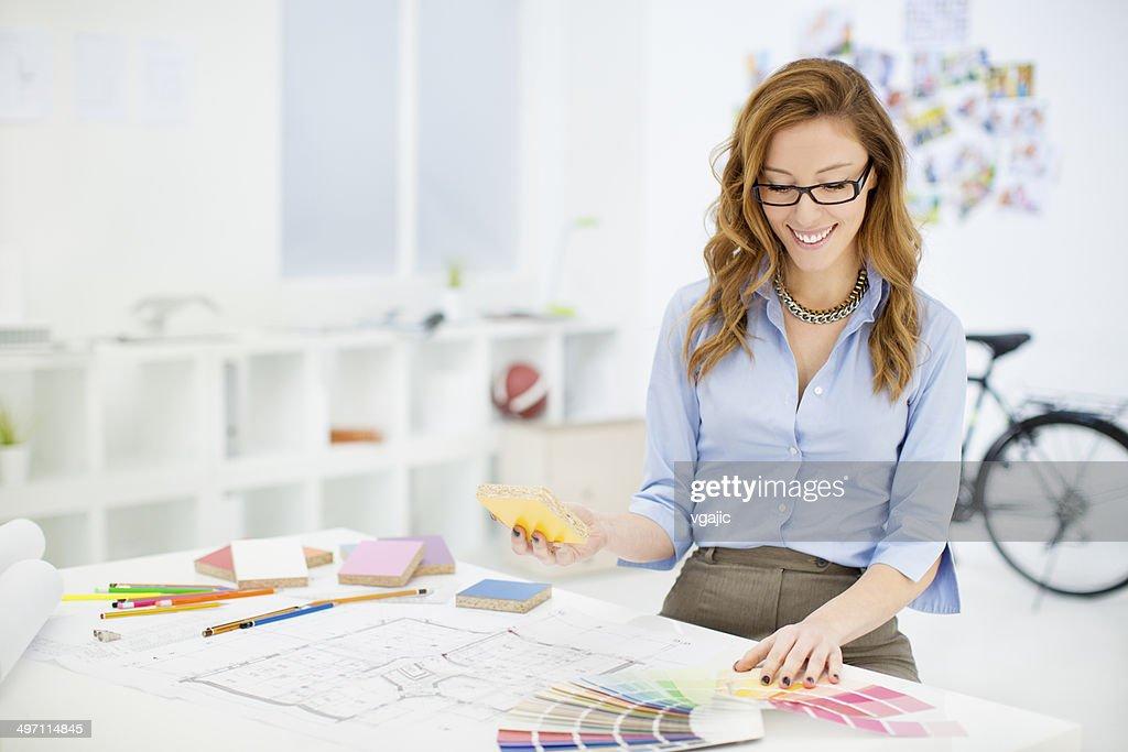 ... Female Interior Designer At Work.