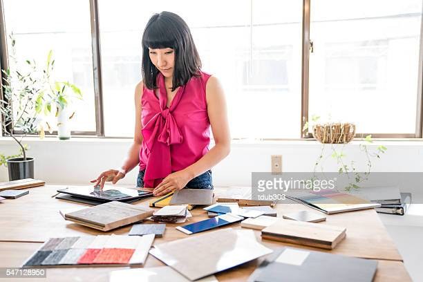 female interior designer working in an architectural firm - interior design foto e immagini stock