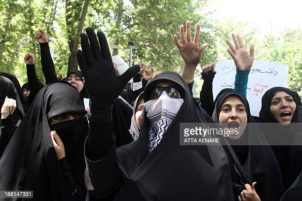Female Iranian students shout slogans as they attend an antiIsraeli demonstration in front of the United Nations offices in Tehran on May 6 to...