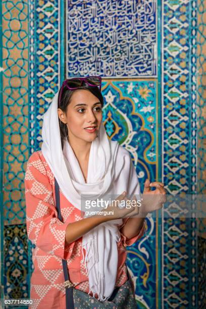 female iranian tourguide wearing a headscarf, yazd, iran - iranian culture stock photos and pictures