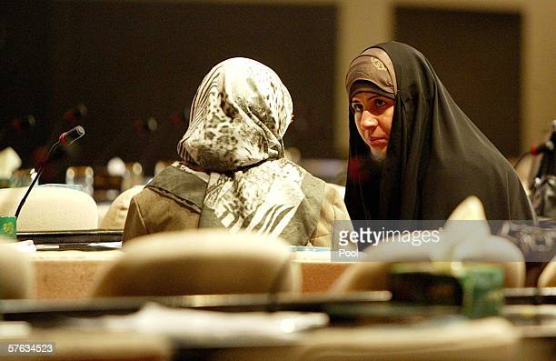 Female Iraqi deputies chat with each other prior to the start of the parliament session in the heavily fortified green zone area May 17 2006 in...