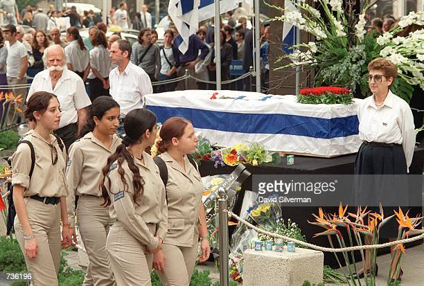 Female Israeli soldiers walk past the flag-draped coffin of Leah Rabin, wife of assassinated former Prime Minister Yitzhak Rabin, during a ceremony...