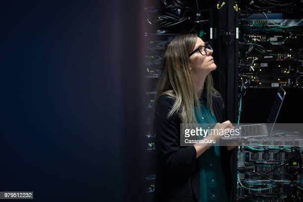 female it engineer checking supercomputer network efficiency - improvement stock pictures, royalty-free photos & images