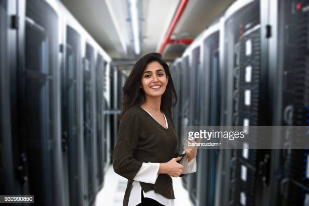 female it engineer in data center - big data storage stock pictures, royalty-free photos & images