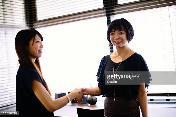 female japanese politicians handshake after bilateral meeting - ambassador stock pictures, royalty-free photos & images