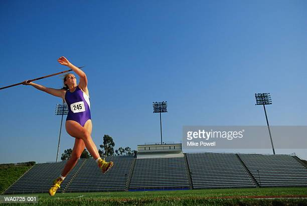 female javelin thrower in action, low angle view - javelin stock pictures, royalty-free photos & images